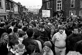 Residents of Treharris, South Wales, parade through the pit village to mark the closure of Deep Navigation colliery. - Philip Wolmuth - 29-03-1991
