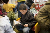 Children's Read-in at Kensal Rise library, Brent. One of six in the borough threatened with closure. - Philip Wolmuth - 2010s,2011,activist,activists,against,anti,Austerity Cuts,BAME,BAMEs,Black,BME,bmes,book,books,boy,boys,campaign,campaigner,campaigners,campaigning,CAMPAIGNS,child,CHILDHOOD,children,communities,commu