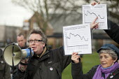 Tim Woodcock, Greenwich NUT and Chair of Greenwich and Bexley Trades Council with graphs showing the low cost of current public debt and borrowing in comparison with earlier periods. March against pro... - Philip Wolmuth - 12-02-2011
