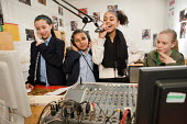 An after-school group in the Avenues FM radio studio at the New Avenues Youth Club, Queen's Park. West London. - Philip Wolmuth - 28-01-2010