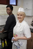 Cook Urszula Renska and a volunteer kitchen assistant at Age Concern Camdens Great Croft Resource Centre in Kings Cross, which is threatened with closure following cuts to the organisations funding by... - Philip Wolmuth - 25-01-2011