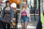 Two teenage girls walk in the High Street, Southend, Essex. - Philip Wolmuth - 12-03-2011