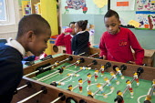 Playing table football After-school club at the Winchester Project, Swiss Cottage, which may close due to cuts to Camden Council's funding. - Philip Wolmuth - 2010s,2011,after school activities,after school activity,after school club,Austerity Cuts,BAME,BAMEs,Black,BME,bmes,boy,boys,child,CHILDHOOD,children,cities,city,club,clubs,Cottage,COTTAGES,council,cu