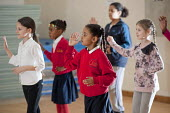 Dance class at an After-school club at the Winchester Project, Swiss Cottage, which may close due to cuts to Camden Councils funding. - Philip Wolmuth - 2010s,2011,ACE,after school activities,after school activity,after school club,BAME,BAMEs,Black,BME,bmes,child,CHILDHOOD,children,cities,city,club,clubs,Cottage,COTTAGES,culture,cuts,dance,dancer,danc