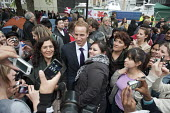 A Prince William lookalike mixes with the crowds outside Westminster Abbey on the eve of the Royal Wedding. - Philip Wolmuth - 2010s,2011,cities,city,families,family,FEMALE,LFL,LIFE,Lifestyle,London,look-alike,male,man,men,monarchy,nationalism,outside,patriot,patriotic,patriotism,patriots,people,person,persons,royal,royalty,S