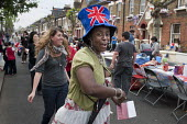 Royal Wedding street party in Kilravock Street, Queens Park, West London. - Philip Wolmuth - 2010s,2011,ACE,black,cities,city,culture,dance,dancer,dancers,dancing,families,family,FEMALE,flag,flags,hat,hats,LFL,LIFE,Lifestyle,London,MARRIAGE,melody,monarchy,multiracial,music,MUSICAL,nationalis