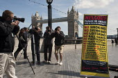 """Photographers protest on the Thames Footpath outside City Hall to highlight restrictions on photography by security guards, and the privatisation of public space across London. Organised by the """"I'm a... - Philip Wolmuth - 03-05-2011"""