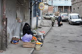An elderly woman selling fruit and vegetables in the street. Georgia - Philip Wolmuth - 07-04-2011