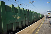 A Waste Recycling Group freight train passes through Cricklewood station. London - Philip Wolmuth - 09-03-2011