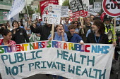 Public health not private wealth. Our Health Service Not for Sale march to save the NHS, London. - Philip Wolmuth - 2010s,2011,activist,activists,against,anti-privatisation,austerity cuts,banner,banners,CAMPAIGN,campaigner,campaigners,CAMPAIGNING,CAMPAIGNS,cuts,DEMONSTRATING,demonstration,DEMONSTRATIONS,FEMALE,heal