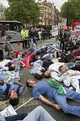 Our Health Service Not for Sale march to save the NHS, London. Protesters lie down in Cambridge Circus. - Philip Wolmuth - 2010s,2011,activist,activists,against,anti-privatisation,austerity cuts,blockade,BLOCKADING,CAMPAIGN,campaigner,campaigners,CAMPAIGNING,CAMPAIGNS,civil disobedience,cuts,DEMONSTRATING,demonstration,DE