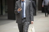 Man with a mobile phone outside Deutsche Bank, City of London. - Philip Wolmuth - 21-06-2011