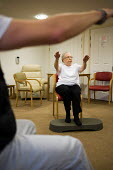 Chair-based exercise class at Esk Moors Lodge, Castleton, North Yorkshire, a sheltered housing scheme and 'extra care' centre run by Esk Moors Caring. - Philip Wolmuth - 01-11-2010