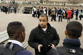 Jabir Uddin, Youth and Community Manager of the Extended School Programme at George Green Secondary School, Isle of Dogs, Tower Hamlets, deals with a playground confrontation. - Philip Wolmuth - ,2000s,2006,adolescence,adolescent,adolescents,BAME,BAMEs,black,BME,bmes,boy,boys,child,CHILDHOOD,children,cities,city,class,communicating,communication,comprehensive,COMPREHENSIVES,conversation,conve