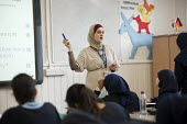 Year 8 Arabic class at Sarah Bonnell Girls' School, Stratford, London, a specialist language college.. - Philip Wolmuth - 2010s,2011,adolescence,adolescent,adolescents,arab,arabic,arabs,BAME,BAMEs,bilingual,Black,BME,bmes,child,CHILDHOOD,children,cities,city,class,classroom,CLASSROOMS,communicating,communication,comprehe