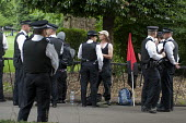 Police stop and search Black Block anarchists in Lincolns Inn Fields before a demonstration London - Philip Wolmuth - 2010s,2011,activist,activists,adult,adults,CAMPAIGN,campaigner,campaigners,CAMPAIGNING,CAMPAIGNS,CLJ,DEMONSTRATING,demonstration,DEMONSTRATIONS,disputes,Fields,INDUSTRIAL DISPUTE,London,looking,MATURE