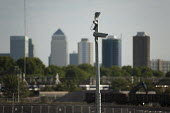 Security camera in the Olympic Park, Stratford, and Canary Wharf towers. - Philip Wolmuth - 01-08-2011