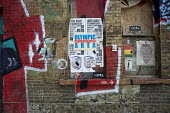 Olympic Gentrification Area. Graffiti and fly-posting on the wall of a disused pub in Hackney Wick. The rundown area next to the London 2012 Olympic Park has seen a recent influx of young artists attr... - Philip Wolmuth - 02-08-2011