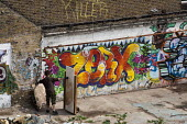 Graffiti and murals in a yard in Hackney Wick. The rundown area of warehouses, small industrial units and tenement blocks next to the London 2012 Olympic Park has seen a recent influx of young artists... - Philip Wolmuth - 02-08-2011