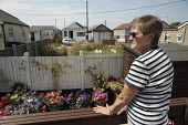 Janet Sharp in her renovated and extended bungalow on the Brooklands Estate in Jaywick Sands close to Clacton-on-Sea. It is the most deprived ward in the UK, according to the most recent Indices of Mu... - Philip Wolmuth - 03-08-2011