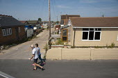 Vandalised bungalows on the Brooklands Estate in Jaywick Sands, close to the Essex resort of Clacton-on-Sea. The estate's small wooden houses - many little bigger than beach huts - were originally bui... - Philip Wolmuth - 03-08-2011