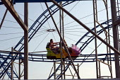 Roller Coaster ride on Clacton pier, Clacton-on-Sea Essex. - Philip Wolmuth - ,2010s,2011,amusement,COAST,coastal,coasts,funfair,holiday,holiday maker,holiday makers,holidaymaker,holidaymakers,holidays,leisure,LFL,LFL lifestyle & leisure,LIFE,OCEAN,PEOPLE,person,persons,pier,re