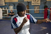 Nicola Adams training at the Tottenham Sports Centre boxing gym. She is a member of the UK womens boxing squad for the London 2012 Olympics, and gold medallist at the 2011 EU Womens Boxing Championshi... - Philip Wolmuth - 2010s,2011,adolescence,adolescent,adolescents,BAME,BAMEs,black,BME,bmes,boxer,boxers,boxing,boxing ring,coach,coaching,diversity,ethnic,ethnicity,female,females,flyweight,Games,girl,girls,gymnasium,Lo