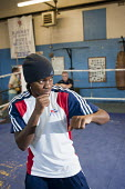 Nicola Adams training at the Tottenham Sports Centre boxing gym. She is a member of the UK womens boxing squad for the London 2012 Olympics, and gold medallist at the 2011 EU Womens Boxing Championshi... - Philip Wolmuth - 04-03-2011