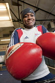 Nicola Adams training at the Tottenham Sports Centre boxing gym. She is a member of the UK womens boxing squad for the London 2012 Olympics, and gold medallist at the 2011 EU Womens Boxing Championshi... - Philip Wolmuth - 2010s,2011,adolescence,adolescent,adolescents,BAME,BAMEs,black,BME,bmes,boxer,boxers,boxing,Boxing Gloves,boxing ring,diversity,ethnic,ethnicity,female,females,flyweight,Games,girl,girls,gymnasium,Lon