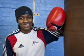 Nicola Adams training at the Tottenham Sports Centre boxing gym. She is a member of the UK womens boxing squad for the London 2012 Olympics, and gold medallist at the 2011 EU Womens Boxing Championshi... - Philip Wolmuth - ,2010s,2011,adolescence,adolescent,adolescents,BAME,BAMEs,black,BME,bmes,boxer,boxers,boxing,Boxing Gloves,diversity,ethnic,ethnicity,female,females,flyweight,Games,girl,girls,gymnasium,London,minorit