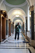 Cleaner on an early morning shift at Islington Town Hall. The 130 cleaners of the borough's 70 municipal buildings are now directly employed by the local authority, following 10 years with private con... - Philip Wolmuth - 2010s,2011,BAME,BAMEs,black,BME,bmes,buildings,by hand,cities,city,cleaner,cleaners,cleaning,cleansing,contractor,contractors,council,Council Services,Council Services,Council Workers,diversity,EARNIN