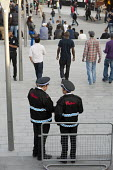 Security guards, Westfield Stratford City, the largest urban shopping centre in Europe. - Philip Wolmuth - 2010s,2011,BAME,BAMEs,black,BME,bmes,bought,buy,buyer,buyers,buying,casual,cities,city,CLJ,commodities,commodity,communicating,communication,community policing,complex,consumer,consumers,conversation,