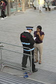 Security guard helping a shopper, Westfield Stratford City, the largest urban shopping centre in Europe. - Philip Wolmuth - 2010s,2011,BAME,BAMEs,black,BME,bmes,bought,buy,buyer,buyers,buying,casual,cities,city,CLJ,commodities,commodity,communicating,communication,community policing,complex,consumer,consumers,conversation,