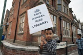 Local residents guard Kensal Library following council attempts to board the building up, on the day of a failed High Court bid to prevent closure of six Brent libraries. - Philip Wolmuth - 2010s,2011,activist,activists,against,anti,Austerity Cuts,boy,boys,building,BUILDINGS,CAMPAIGNING,CAMPAIGNS,child,CHILDHOOD,children,CLOSED,closing,closure,closures,council,Court,cuts,DEMONSTRATING,de