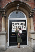 Local residents guard Kensal Library following council attempts to board the building up, on the day of a failed High Court bid to prevent closure of six Brent libraries. - Philip Wolmuth - 2010s,2011,activist,activists,adult,adults,against,anti,Austerity Cuts,building,BUILDINGS,CAMPAIGNING,CAMPAIGNS,child,CHILDHOOD,children,CLOSED,closing,closure,closures,council,Court,cuts,DEMONSTRATIN