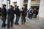 Starbucks toilet queue. Occupy the London Stock Exchange. Protesters gather at St.Pauls Cathedral on a global day of action against corporate greed. - Philip Wolmuth - 15-10-2011