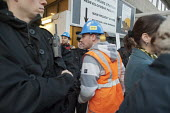 An agency worker going into the site. Electricians and supporters protest outside Blackfriars Station Redevelopment construction site to protest at plans by contractor Balfour Beatty to cut wages by 3... - Philip Wolmuth - 19-10-2011
