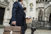 Legal workers arrive at the Royal Courts of Justice a box of case papers and documents, London. - Philip Wolmuth - 27-09-2011
