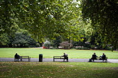 People sitting on park benches in Lincoln's Inn Fields, London - Philip Wolmuth - 27-09-2011