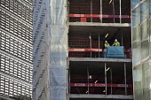 Construction workers on a high rise office development in the City of London. - Philip Wolmuth - 09-11-2011