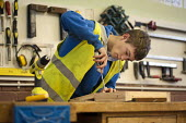 A 15 year old school drop-out working in a carpentry workshop while on placement at a college run by Barnsley Community Build, a social enterprise, South Yorkshire. - Philip Wolmuth - 07-11-2011