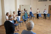 A chair-based keep fit exercise class at Swiss Cottage Community Centre. London - Philip Wolmuth - 2010s,2011,adult,adults,age,ageing population,Camden,chair,chairs,cities,city,clap,clapping,claps,communities,Community,Cottage,COTTAGES,Council,elderly,employee,employees,Employment,exercise,exercise
