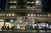 Koch brothers dirty money. Protest outside the City of London offices of Koch Industries, which funds American proponents of Climate Change Denial. The second biggest privately owned corporation in th... - Philip Wolmuth - 2010s,2011,activist,activists,against,American,americans,anti,banner,banners,brothers,CAMPAIGN,campaigner,campaigners,CAMPAIGNING,CAMPAIGNS,climate,Climate Change,DEMONSTRATING,demonstration,DEMONSTRA