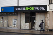 Empty shoe shop in the centre of Doncaster. - Philip Wolmuth - ,2010s,2011,cities,city,close,closed,closed down,closing,closure,closures,decline,down,DOWNTURN,EBF,economic,Economic Crisis,Economy,Empty,FEMALE,High Street,jobless,jobseeker,jobseekers,Marginalised,