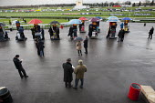 National Hunt meeting at Doncaster racecourse. - Philip Wolmuth - &,2010s,2011,bet,bets,betting,bookie,bookies,bookmakers,CLIMATE,conditions,course,courses,domesticated ungulates,equestrian,equine,gambler,gamblers,gambling,HORSE,horse-racing,horses,leisure,LFL,LIFE,