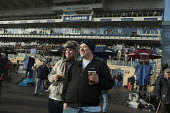 Race gowers enjoying a pint. National Hunt meeting at Doncaster racecourse. - Philip Wolmuth - &,2010s,2011,alcohol,beer,beer-drinkers,bet,bets,betting,course,courses,domesticated ungulates,drink,drinker,drinkers,drinking,drinks,enjoying,ENJOYMENT,equestrian,equine,gambler,gamblers,gambling,HOR