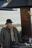 On-course bookmaker at Doncaster racecourse. - Philip Wolmuth - &,2010s,2011,age,ageing population,bet,bets,betting,bookie,bookies,bookmaker,bookmakers,course,courses,domesticated ungulates,elderly,employee,employees,Employment,equestrian,equine,gambler,gamblers,g