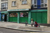 Mini market shop on the Mozart Estate, North Westminster, which has experienced problems with postcode gang violence. - Philip Wolmuth - 2010s,2011,adult,adults,Asian,babies,baby,BAME,BAMEs,black,BME,BME black,bmes,bought,buy,buyer,buyers,buying,child,child children,CHILDHOOD,children,cities,city,commodities,commodity,consumer,consumer