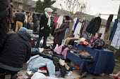Car boot sale, Kilburn, London. - Philip Wolmuth - 2010s,2012,apparel,boot,bought,buy,buyer,buyers,buying,cities,city,clothes,clothing,commodities,commodity,consumer,consumers,customer,customers,EBF Economy,EQUALITY,excluded,exclusion,FEMALE,goods,HAR