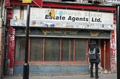 Closed estate agents premises in Shoreditch, London,. - Philip Wolmuth - 2010s,2012,backpack,cities,city,closed,closing,closure,closures,derelict,DERELICTION,disused,EBF,Economic,Economy,empty,Estate Agent,Estate Agents,Estate Agent,Estate Agents,FEMALE,housing,housing Mar